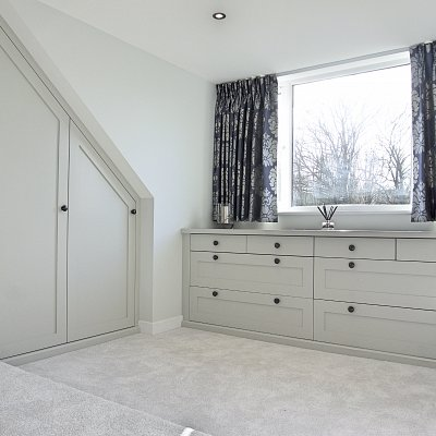 <p>Fitted bedroom furniture that reflects the light, adds character and most importantly keeps a myriad of 'stuff' organised and out of sight!<br /> Handmade, bespoke, lay-on fitted bedroom furniture that is painted in Farrow &amp; Ball's Pavillion Grey &#8211; cool, calm &amp; collected.</p>